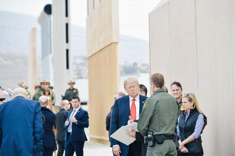 President Donald Trump is shown border wall prototypes