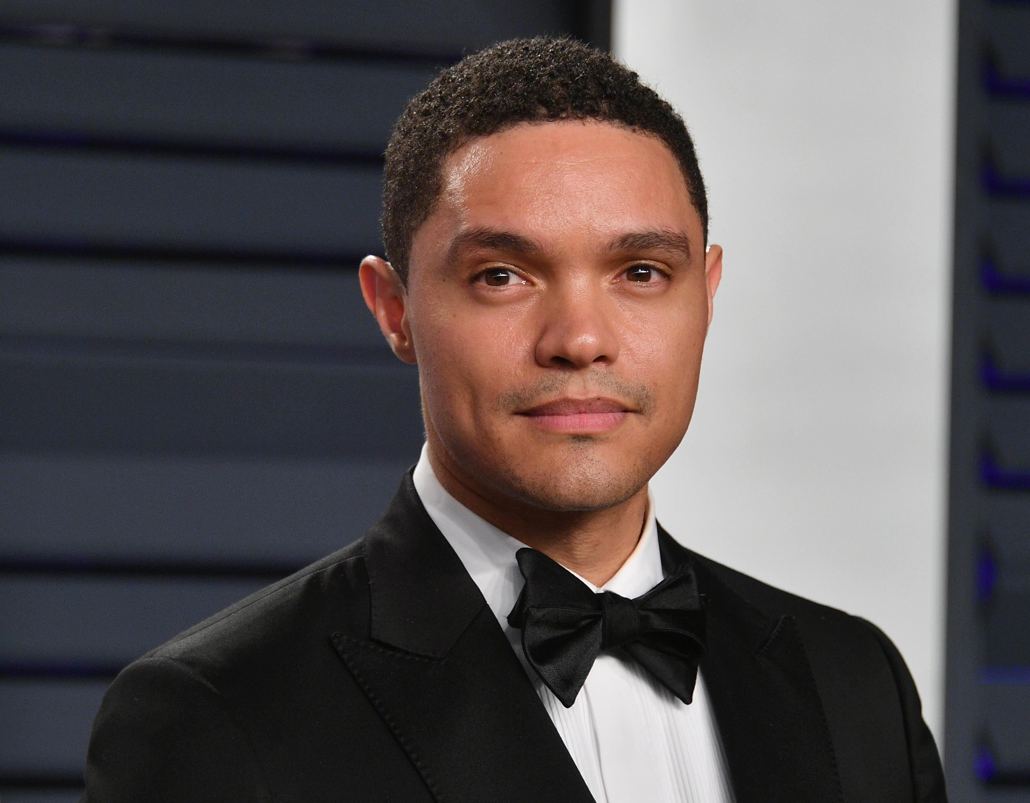 Close up of Daily Show Host Trevor Noah wearing a tuxedo and a black bow tie