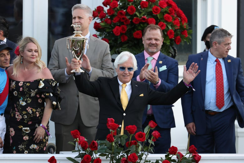 Trainer Bob Baffert raises the trophy after winning the 147th running of the Kentucky Derby with Medina Spirit, his seventh career Kentucky Derby win, at Churchill Downs on May 1, 2021 in Louisville, Kentucky.