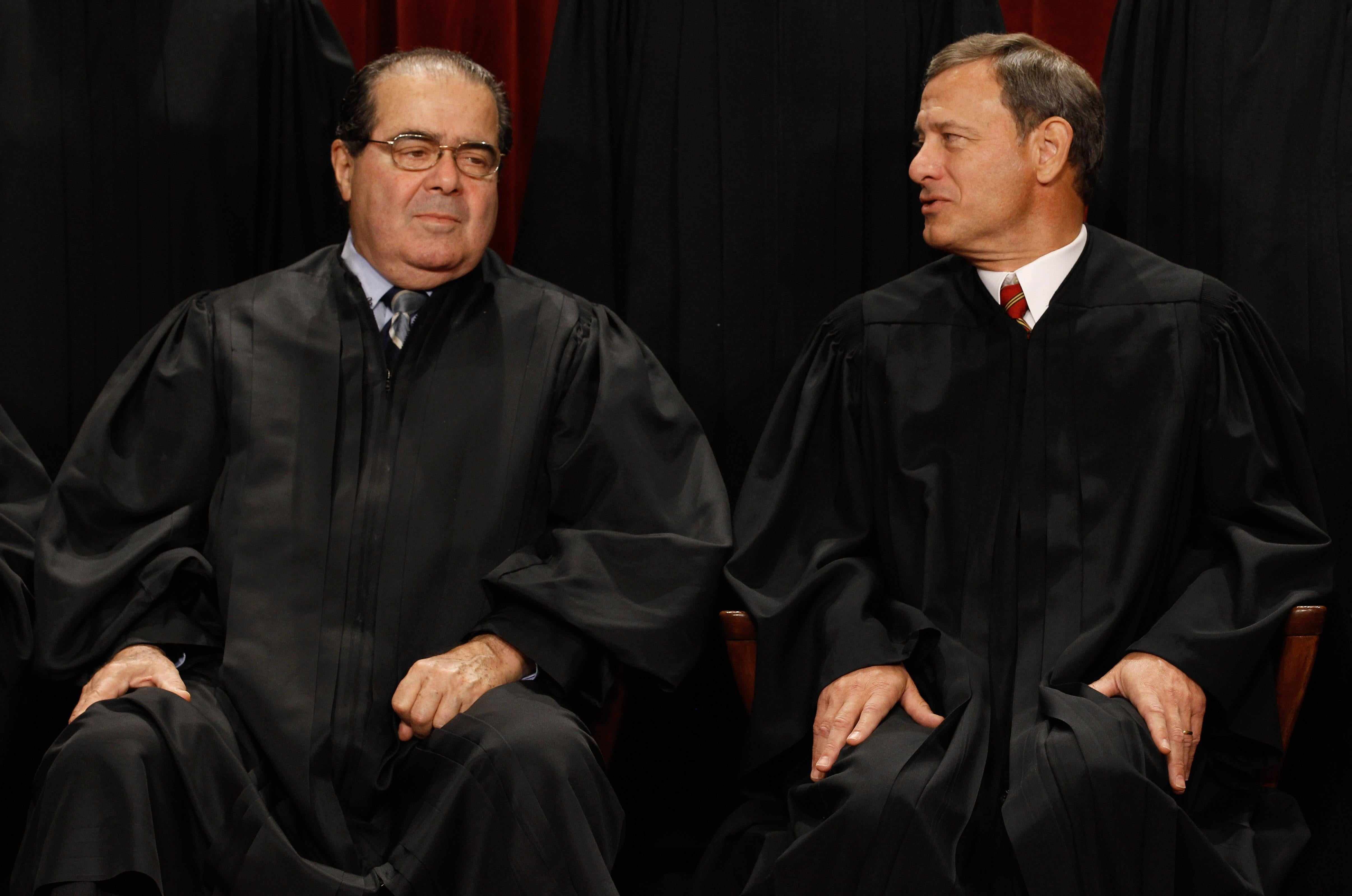 Justice Antonin Scalia (left; shown here with Chief Justice John Roberts) had pointed exchanges with Solicitor General Donald Verrilli during Tuesday's arguments regarding the Affordable Care Act's individual mandate