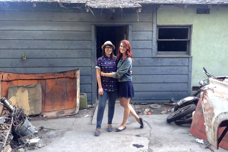 Aubree Bernier-Clarke and Jordan Strang in front of their burned-down shack.