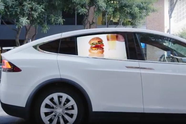 A Grabb-It ad in a car window.