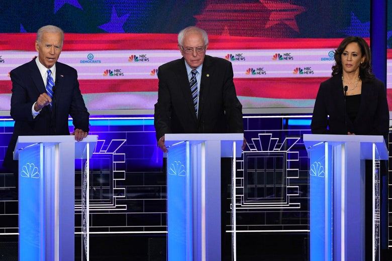 Biden, Sanders, and Harris on the debate stage.