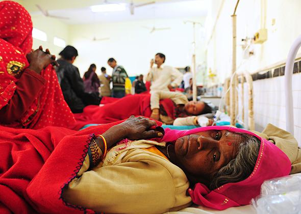 Bittan Devi, a Hindu devotee injured during an overnight stampede at the main railway station, receives treatment at a hospital in Allahabad, India, on Feb. 11, 2013.