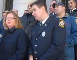 Attorney Karen Torre and firefighter Frank Ricci. Click image to expand.