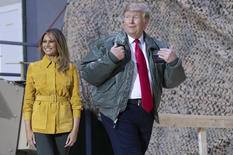 President Donald Trump and First Lady Melania Trump arrive to speak to members of the US military during an unannounced trip to Al Asad Air Base in Iraq on December 26, 2018.
