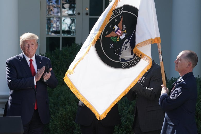 President Donald Trump applauds as the flag for the new U.S. Space Command is revealed in the Rose Garden at the White House August 29, 2019 in Washington, D.C.
