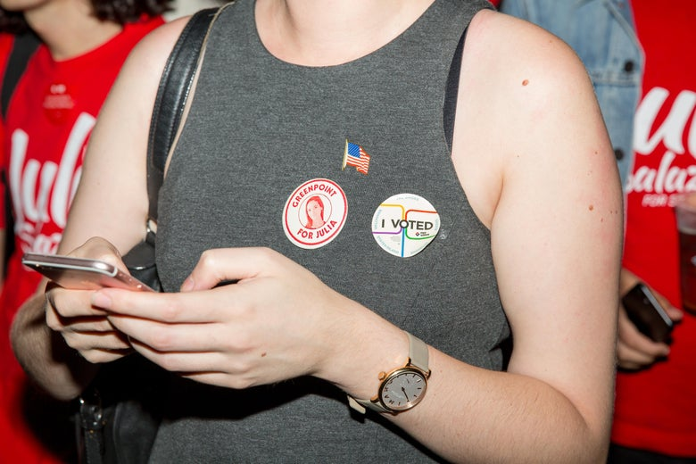 A supporter of the Democratic Socialist candidate Julia Salazar wears stickers on her shirt on the night of the New York State Primary moments before Salazar defeated incumbent Democrat State Senator Marty Dilan on September 13, 2018 in New York City.