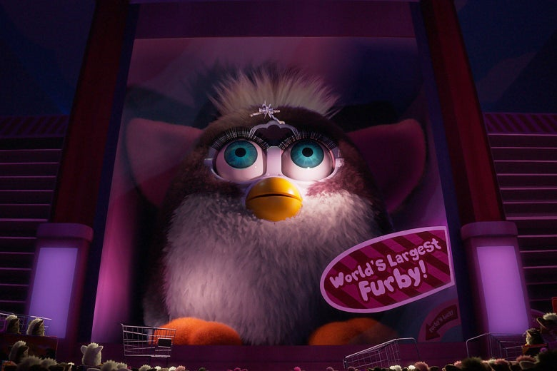 "A menacingly lit, giant Furby, labeled cheerfully ""World's largest Furby!"""