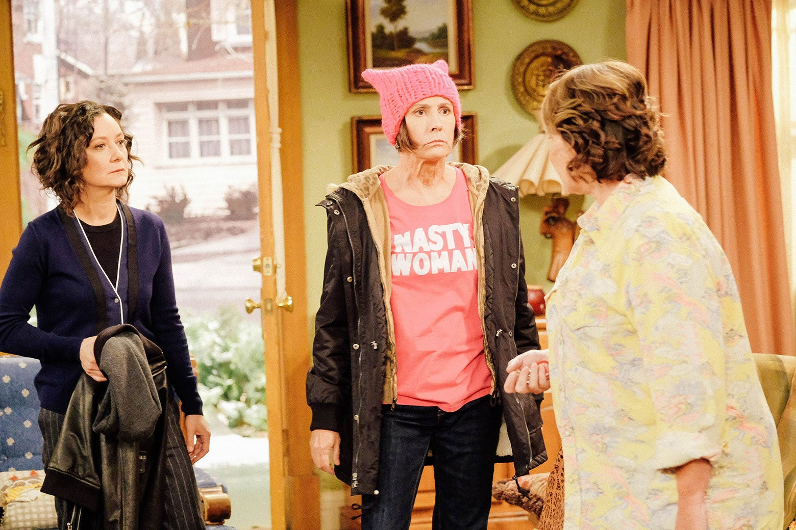 Sara Gilbert, Laurie Metcalf, and Roseanne Barr in a scene from Roseanne.