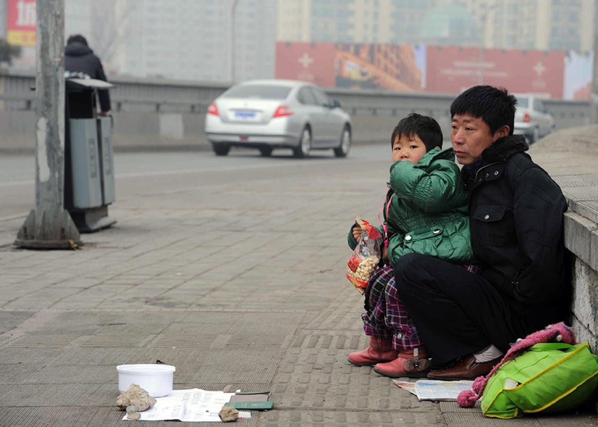 A homeless Chinese man offers his 6-year-old daughter up for adoption.