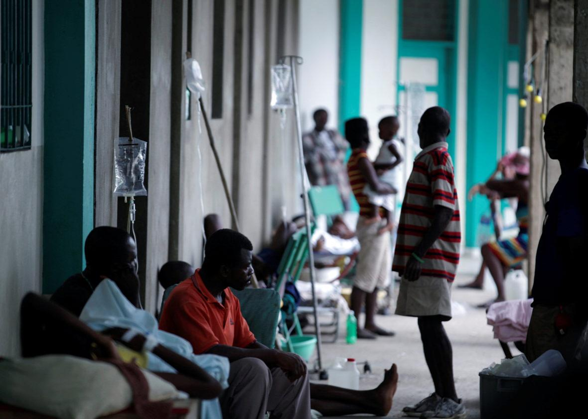 Relatives and patients treated for cholera after Hurricane Matthew in the Hospital of Port-a-Piment, Haiti, October 9, 2016.