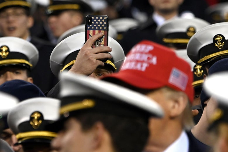 A man takes a picture as President Donald Trump attends the Army-Navy football game in Philadelphia, Pennsylvania on December 14, 2019.