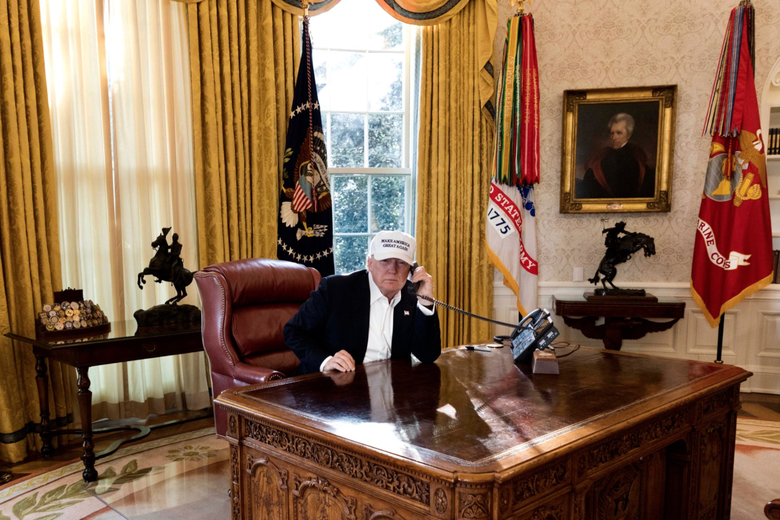 "President Donald Trump is seen ""working"" in this photo released by the White House on Jan. 20, 2018."