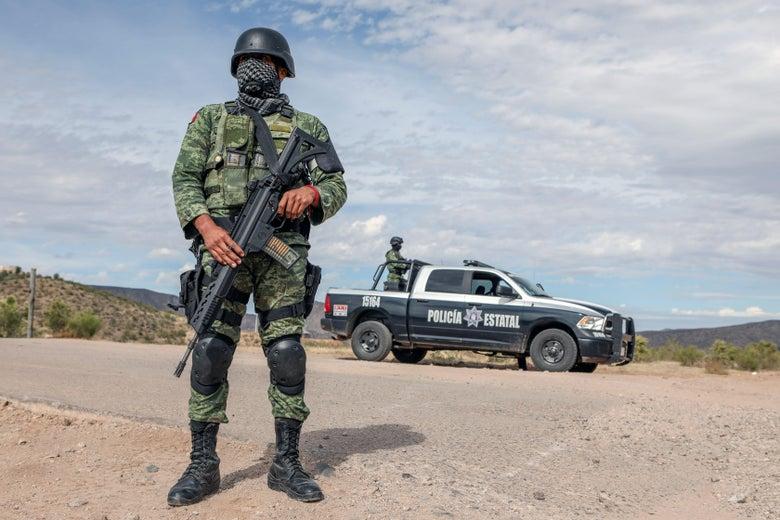 Members of the National Guard stand guard near La Morita ranch.