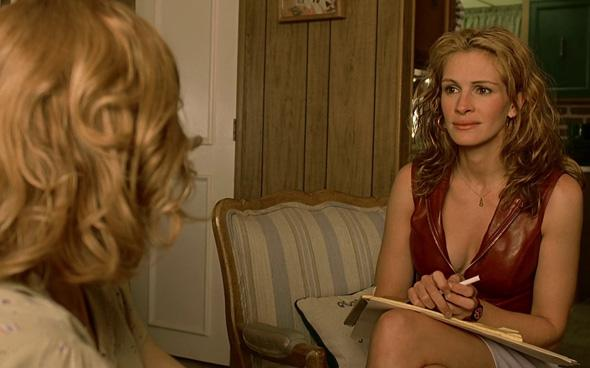 Julia Roberts as Erin Brockovich.