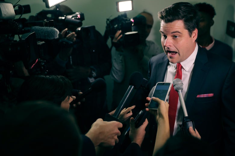 Matt Gaetz speaking to reporters, looking agitated.