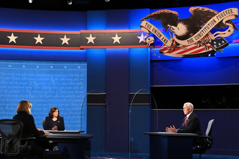 Harris and Pence are seen separated by glass onstage, with Susan Page watching.