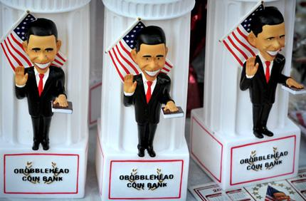 Obama coin banks are for sale near the Time Warner Cable Arena in Charlotte, North Carolina.