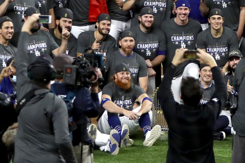Justin Turner #10 and the Los Angeles Dodgers pose for a photo after defeating the Tampa Bay Rays 3-1 in Game 6 to win the 2020 MLB World Series.