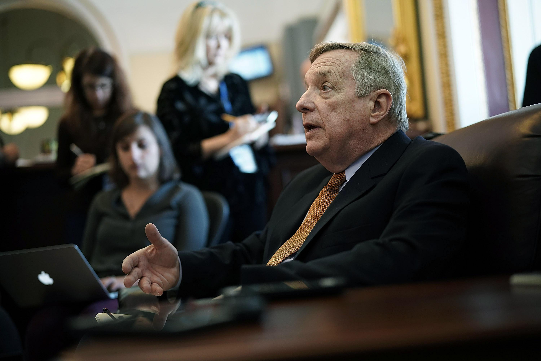 Sen. Dick Durbin speaks to reporters on Monday.
