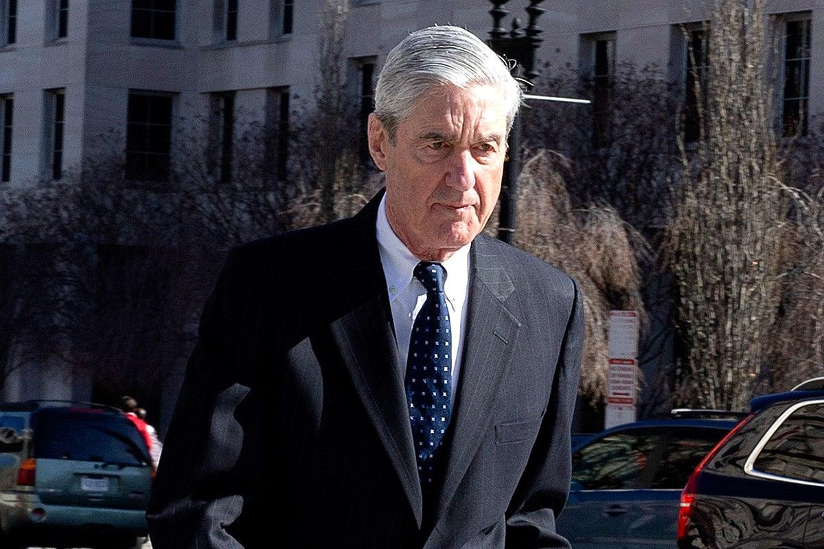 Robert Mueller walks in Washington.