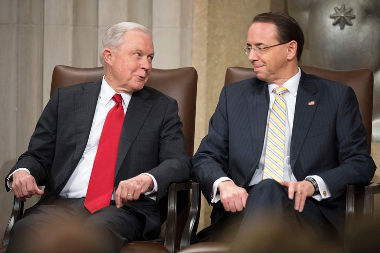 Jeff Sessions and Rod Rosenstein seated next to each other at an awards ceremony.