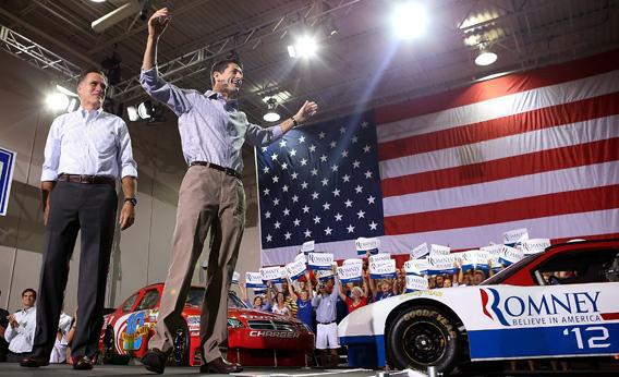 Mitt Romney, left, and running mate Rep. Paul Ryan (R-WI) greet supporers during a campaign rally.