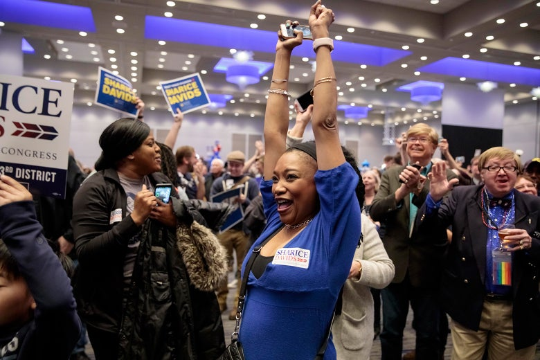 Supporters of Democratic candidate for Kansas' 3rd Congressional District Sharice Davids react to election results during a watch party on Nov. 6, 2018 in Olathe, Kansas.