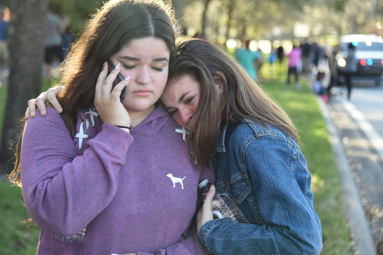 Students react following a shooting at Marjory Stoneman Douglas High School in Parkland, Florida, a city about 50 miles (80 kilometers) north of Miami on February 14, 2018. A gunman opened fire at the Florida high school, an incident that officials said caused 'numerous fatalities' and left terrified students huddled in their classrooms, texting friends and family for help. The Broward County Sheriff's Office said a suspect was in custody. / AFP PHOTO / Michele Eve Sandberg        (Photo credit should read MICHELE EVE SANDBERG/AFP/Getty Images)