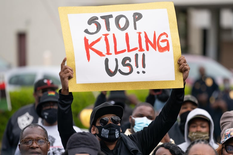 Demonstrators gather outside a government building during an emergency city council meeting April 23, 2021 in Elizabeth City, North Carolina.