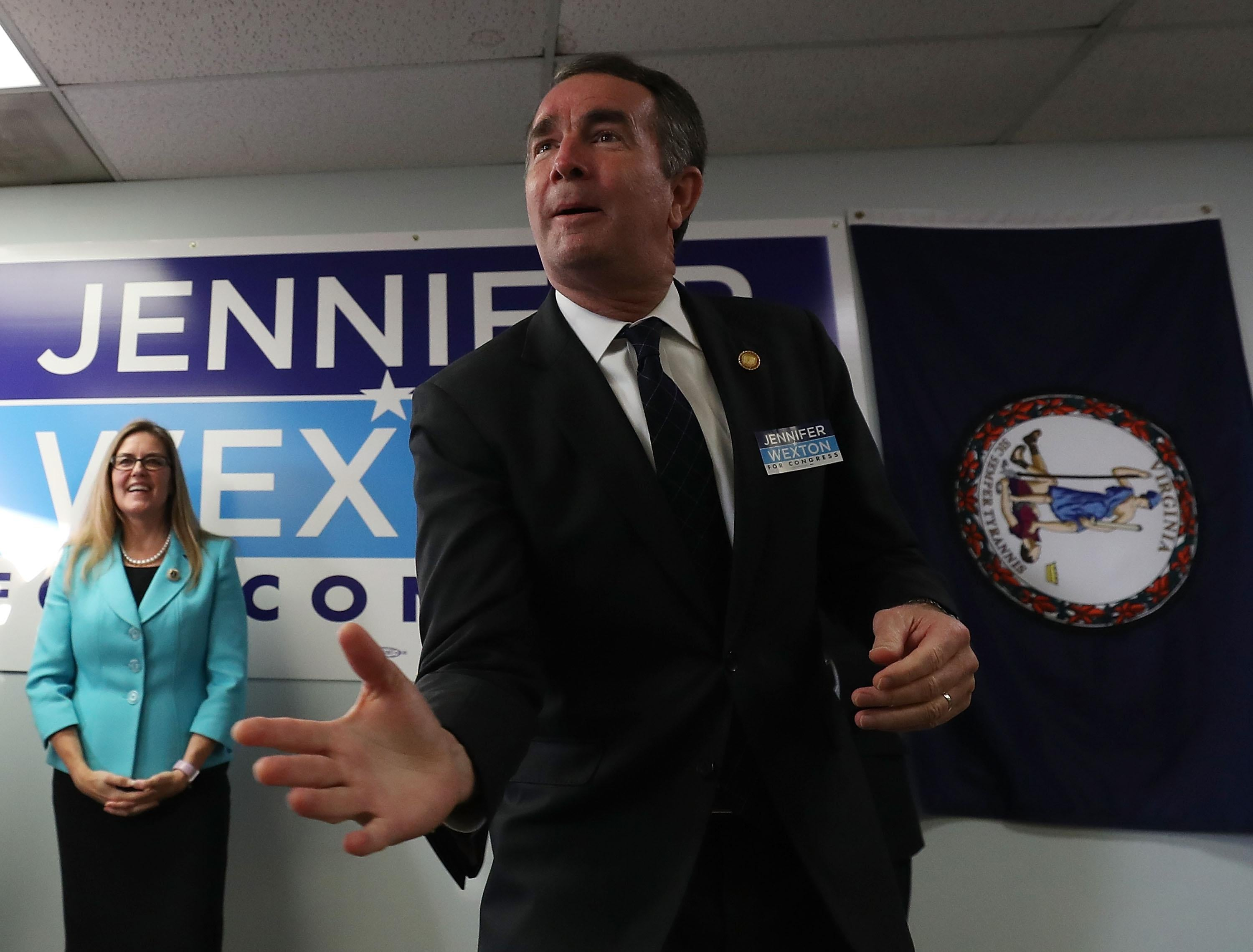 Virginia Gov. Ralph Northam speaks while flanked by Virginia State Senator and candidate for the U.S. House of Representatives Jennifer Wexton during a rally at the Wexton campaign headquarters on October 30, 2018 in Sterling, Virginia.