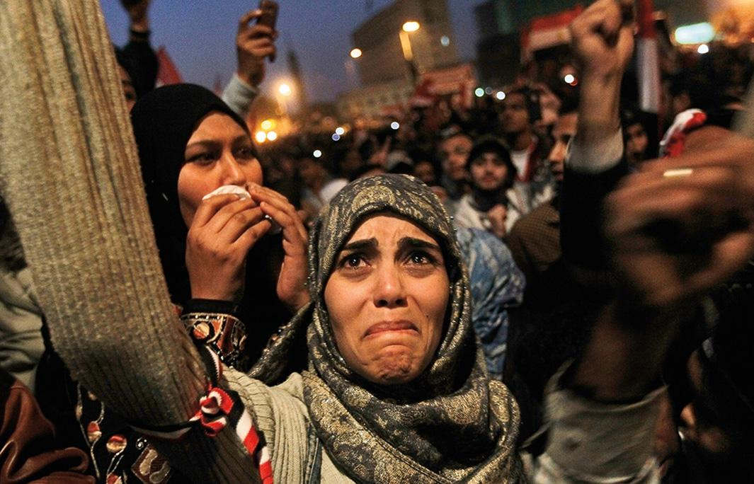 A woman cries in Tahrir Square after the announcement that former Egyptian President Hosni Mubarak was giving up power on Feb. 11, 2011, in Cairo. Hundreds of thousands of Egyptians took to the streets as news of Mubarak's resignation spread.