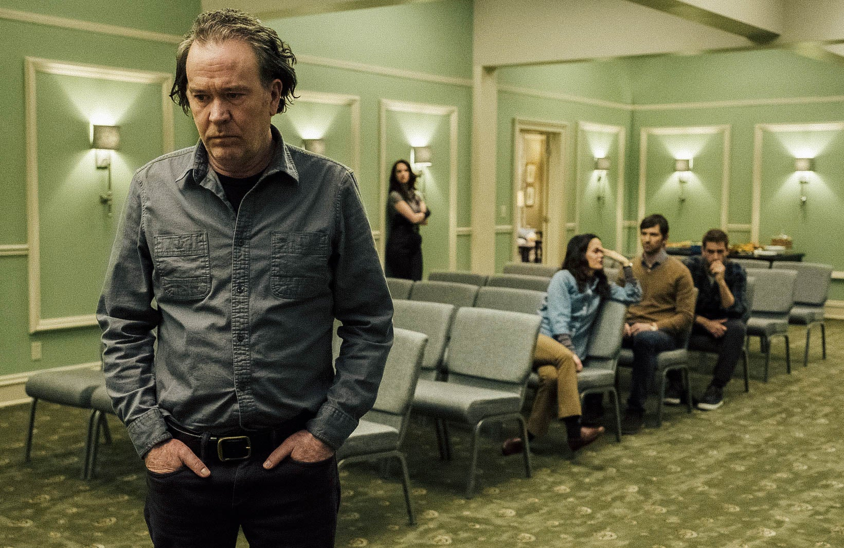 Timothy Hutton stands apart from the rest of his cast family in The Haunting of Hill House.