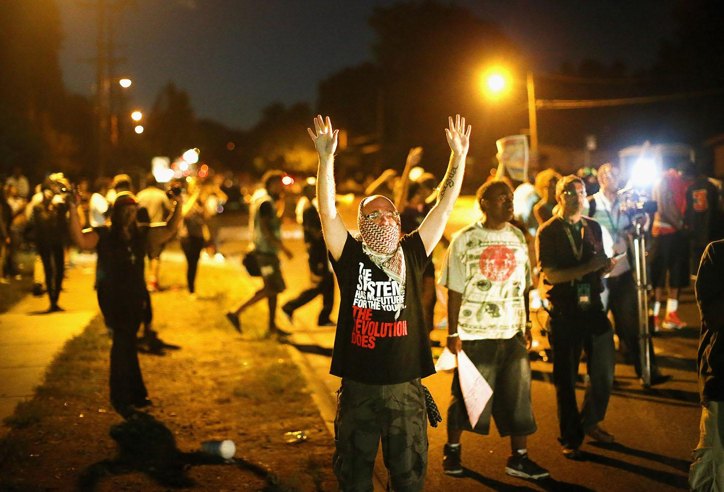 Demonstrators protest the shooting death of teenager Michael Brown on August 13, 2014 in Ferguson, Missouri.