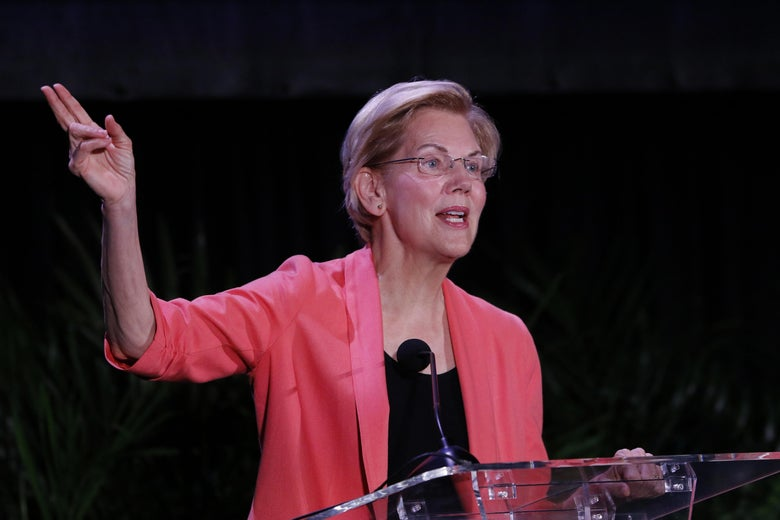 Warren speaks at a podium during the NALEO Presidential Candidate Forum in Miami on June 21.