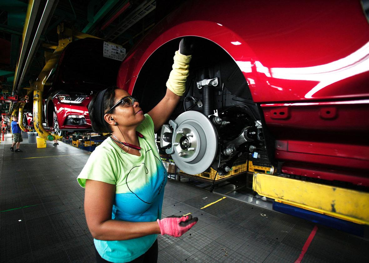 2015 Ford Mustangs go through assembly at the Ford Flat Rock Assembly Plant August 20, 2015 in Flat Rock, Michigan.