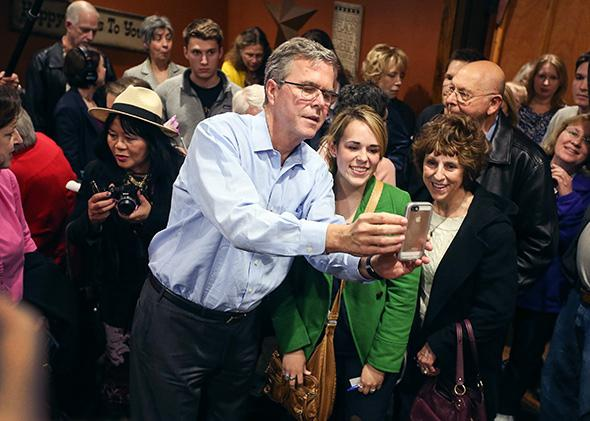 Former Florida Governor Jeb Bush campaigning and taking selfies