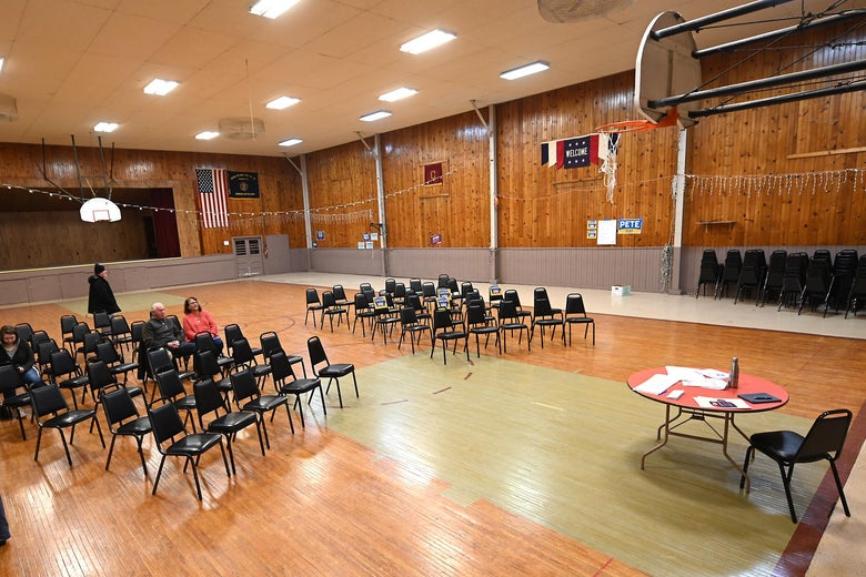 An almost empty gym with empty chairs awaiting caucus goers.