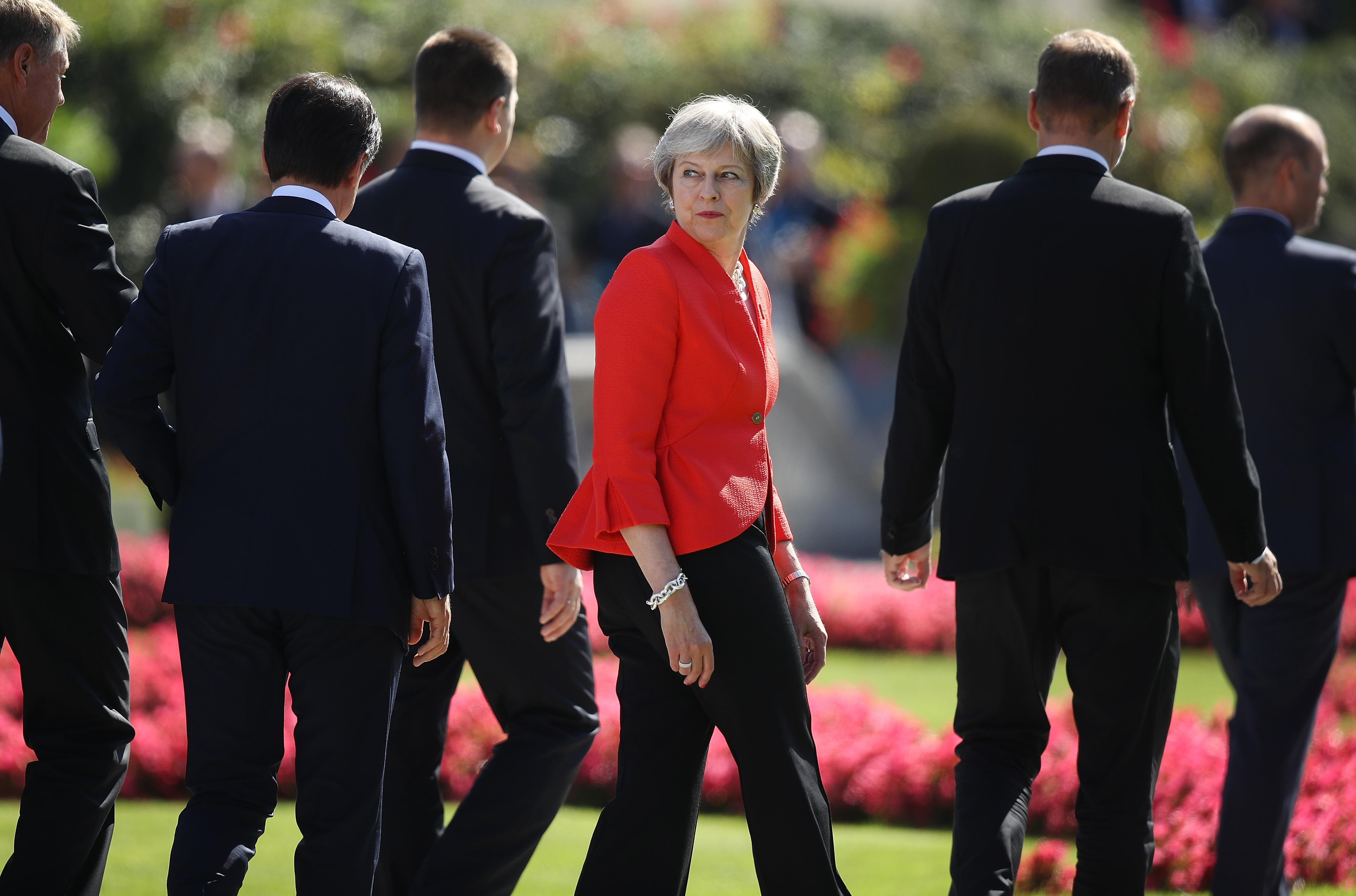 British Prime Minister Theresa May looks back as she and other leaders depart following the family photo on the second day of an informal summit of leaders of the European Union on September 20, 2018.