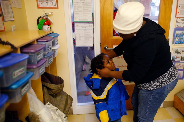 A mother picks up her child from a Head Start program in Massachusetts.