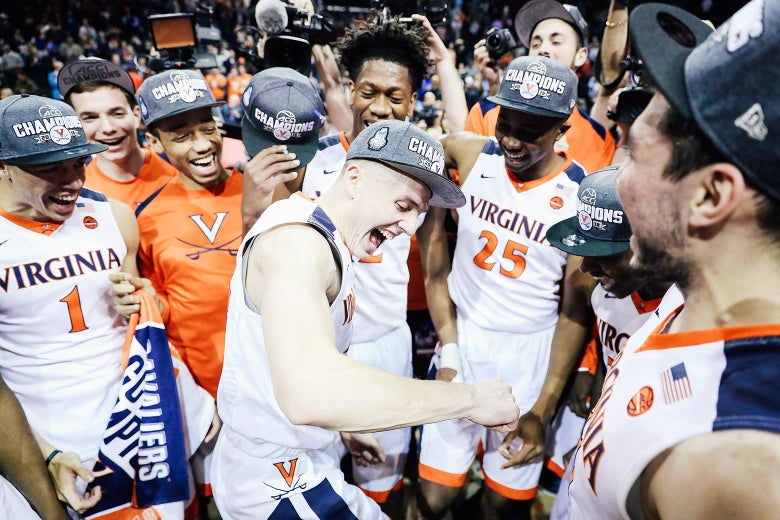 Tournament MVP Kyle Guy of the Virginia Cavaliers celebrates with teammates after defeating the North Carolina Tar Heels 71–63 during the championship game of the 2018 ACC Men's Basketball Tournament at Barclays Center on Sunday in New York City.