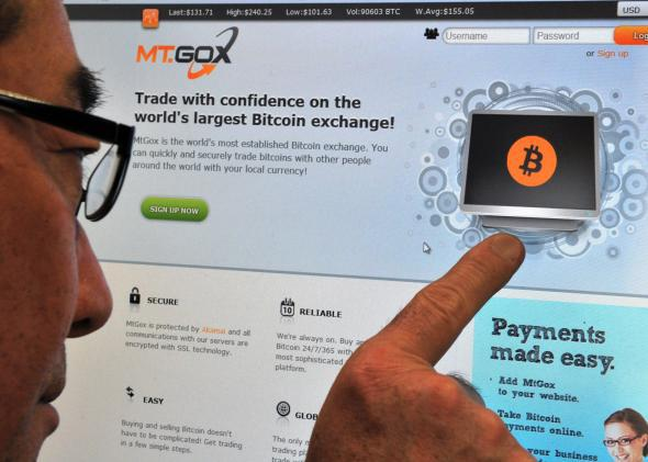 A man looking at the bitcoin exchange website of MtGox in Tokyo on February 25, 2014.