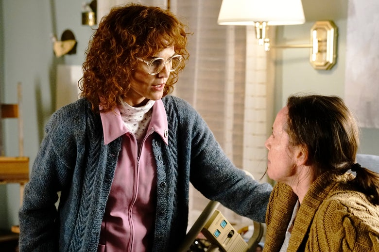 Elizabeth (Keri Russell, dressed in a truly insane disguise featuring bushy red wig and huge glasses) looks after dying artist Erica (Miriam Shor).