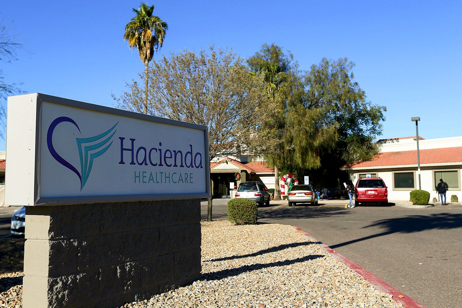 File photo of the Hacienda HealthCare sign and building in Phoenix.