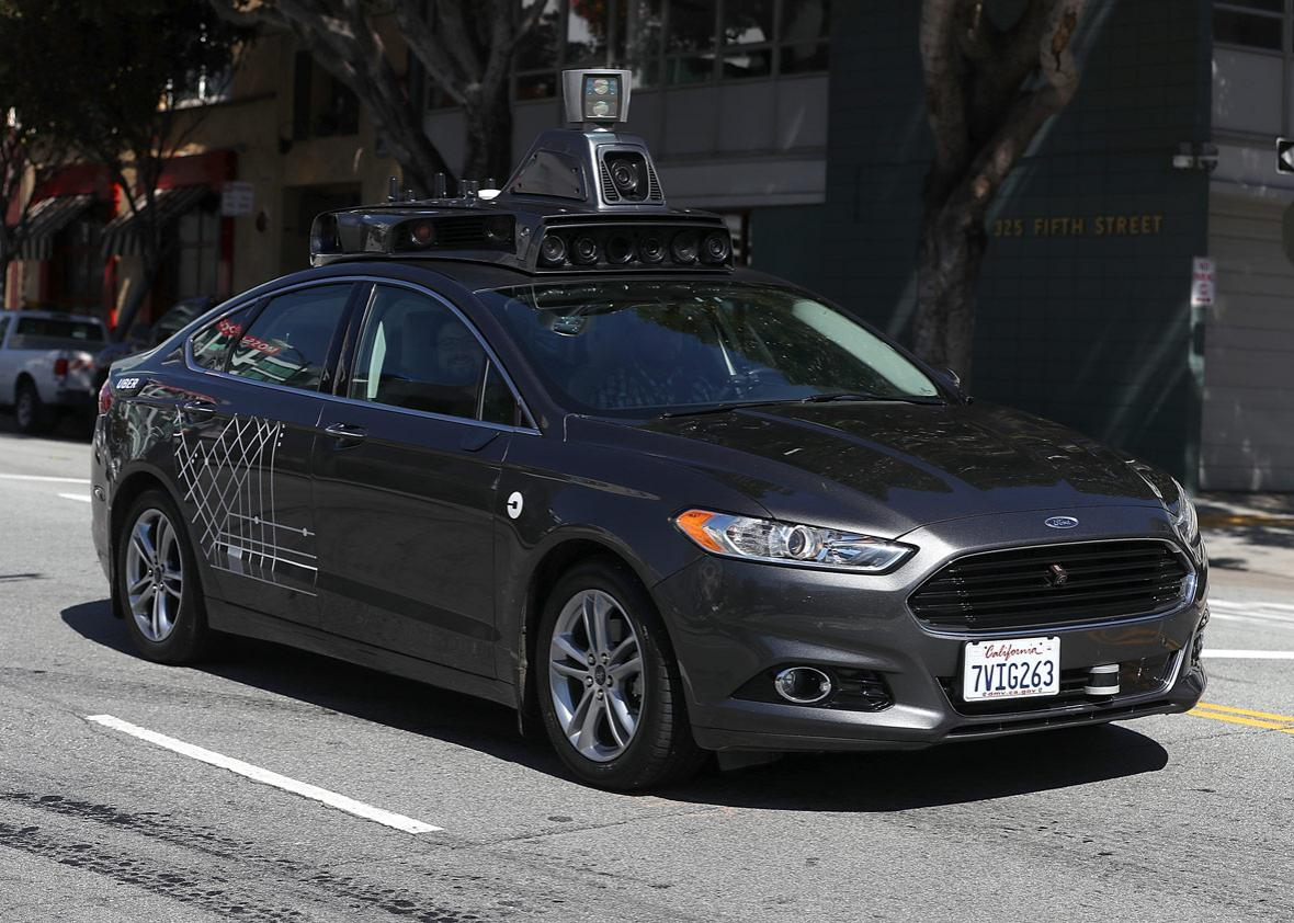 An Uber self-driving car drives.