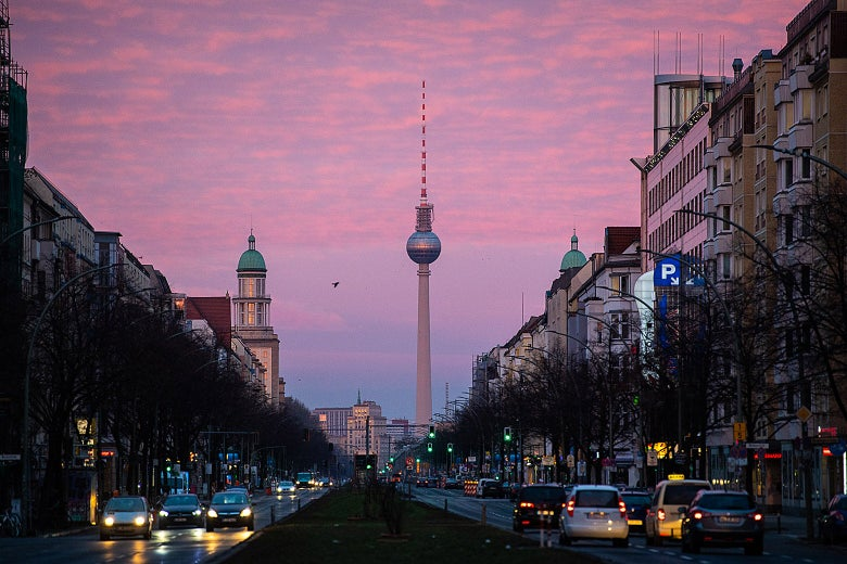 A Berlin street at sunrise with the TV Tower in the background
