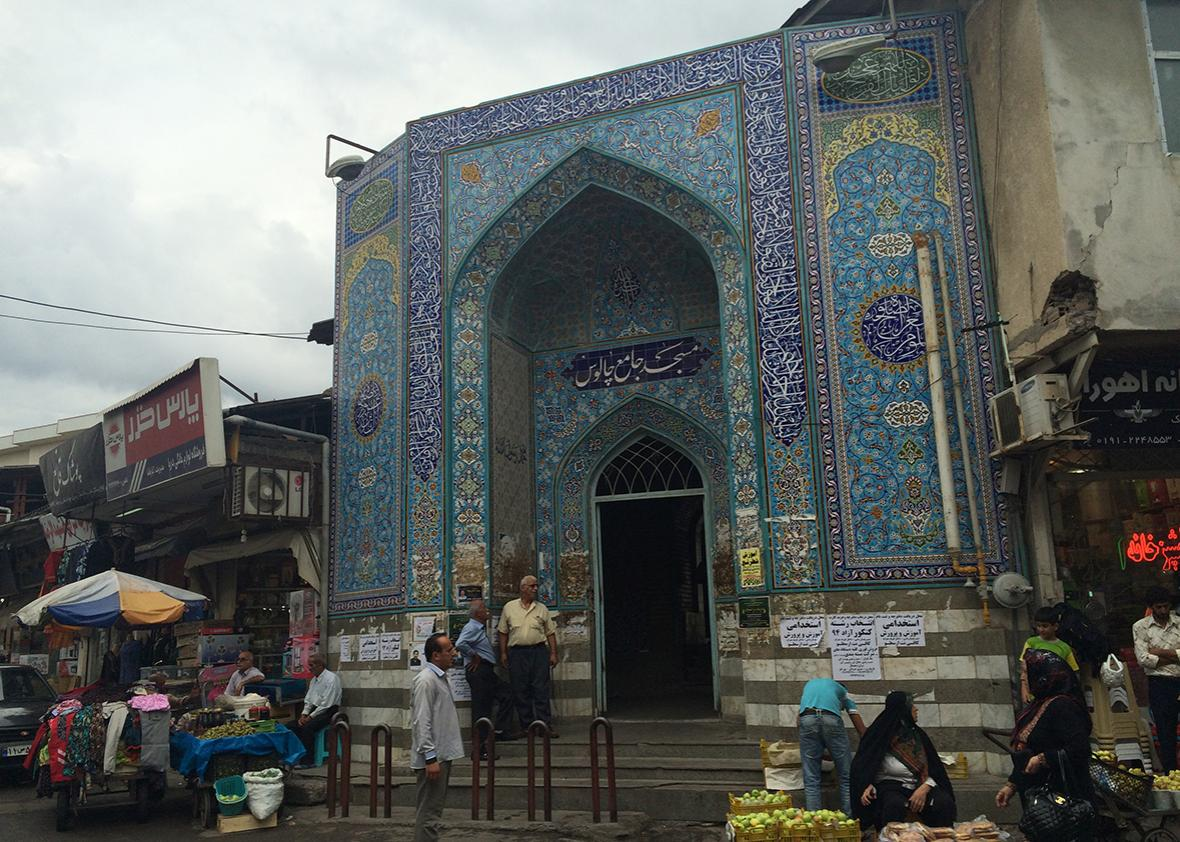 A small mosque in the traditional Iranian style in the center of Chalus' small bazaar, dominated by local farmers.