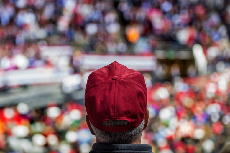 A man in a Make America Great Again hat listens as President Trump at rally in Fort Wayne, Indiana on Nov. 5, 2018.