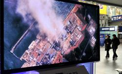 TV reporting an explosion and feared meltdown of Japan's Fukushima-Daiichi Nuclear Power Plant. Click image to expand.